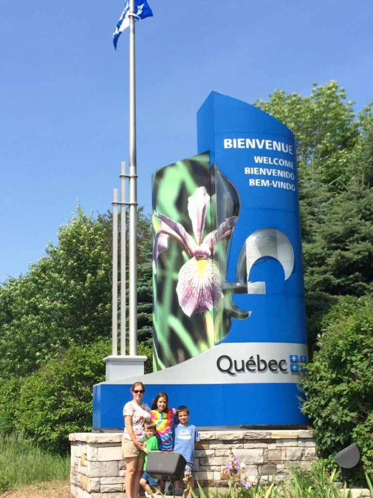 Welcome to Quebec sign. What do I need to drive into Canada with Kids