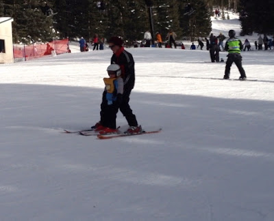 My youngest heading down his first green run with his ski instructor. Family friendly ski resort