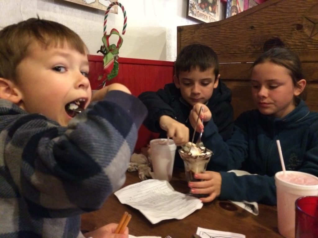 Is it ever too cold for ice cream? Not for the carful of kids. Fort Davis Drug, Texas,