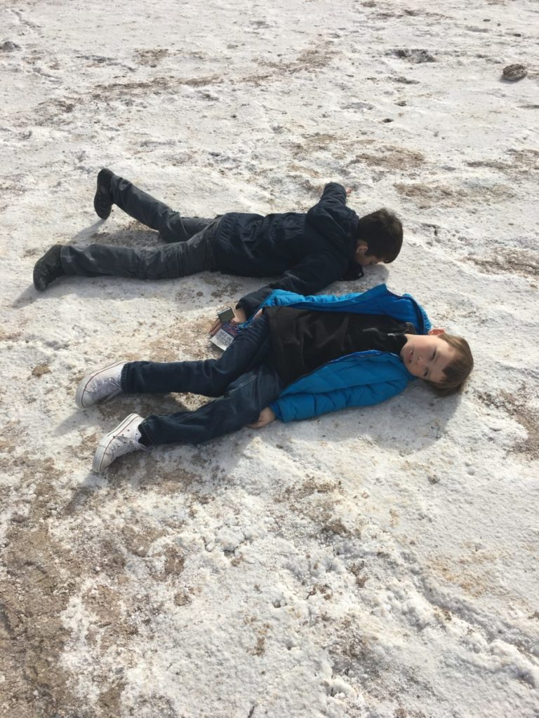 My boys imitate dead in Death Valley. national parks, carful of kids