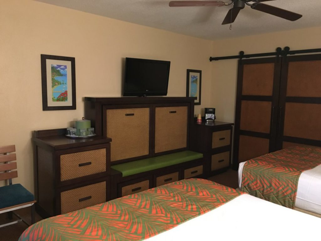 The interior of the Caribbean Beach Resort with the TV, coffee maker and trundle-hiding credenza. Caribbean Beach Resort, Walt Disney Resort,