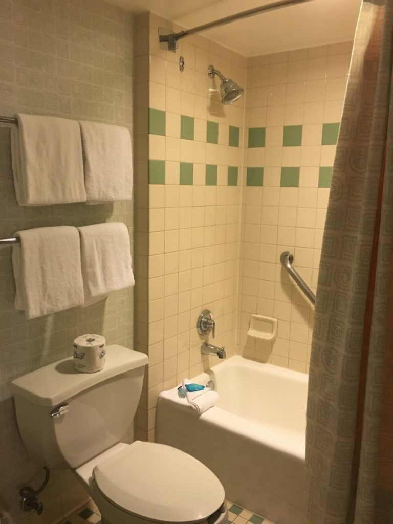 The tub and toilet area is clean and well-maintained. resort review of the Pop Century Resort,