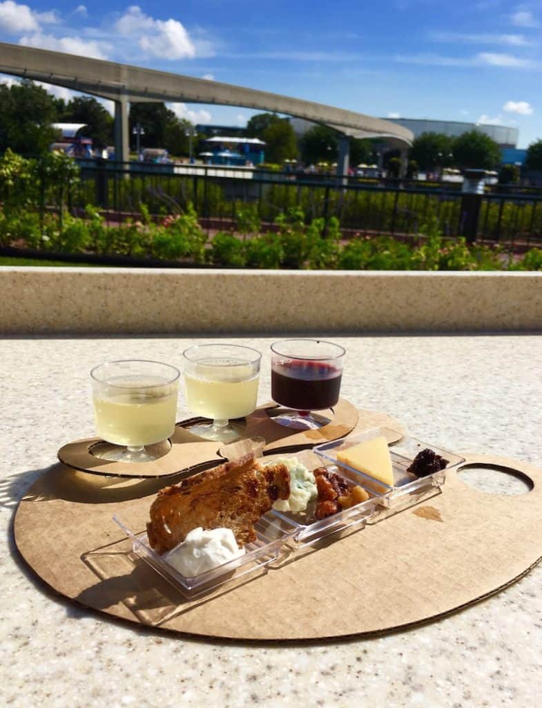 What to eat at the International Food and Wine Festival, like a classic cheese plate paired with wine.