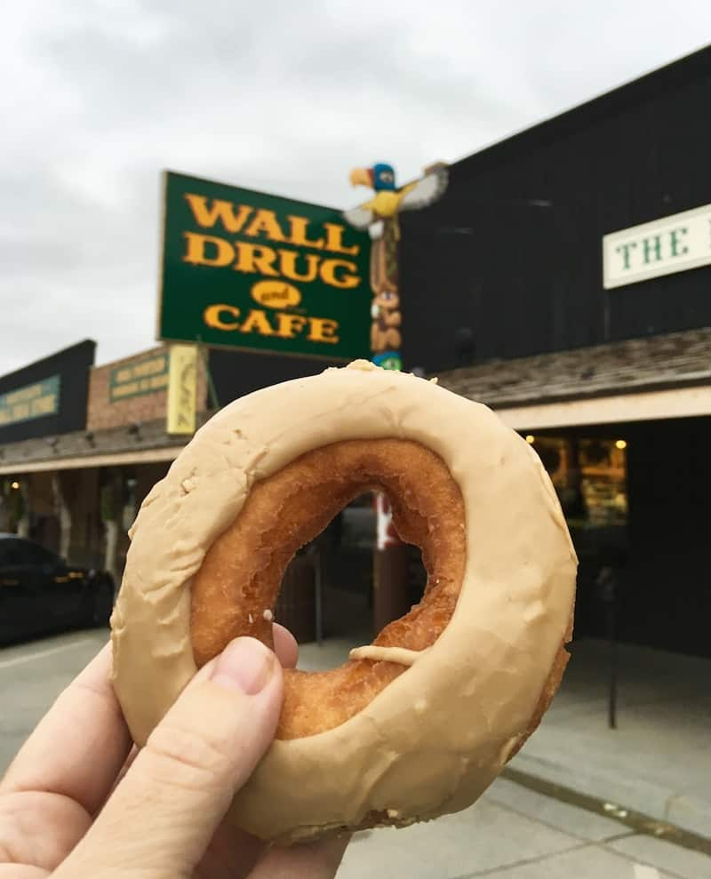 Enjoy a fresh donut at Wall Drug Store in South Dakota.
