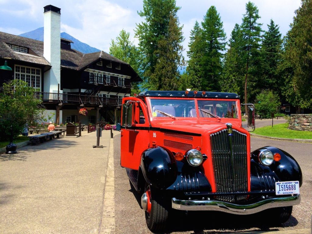The red tour buses are things to do in glacier national park with kids.