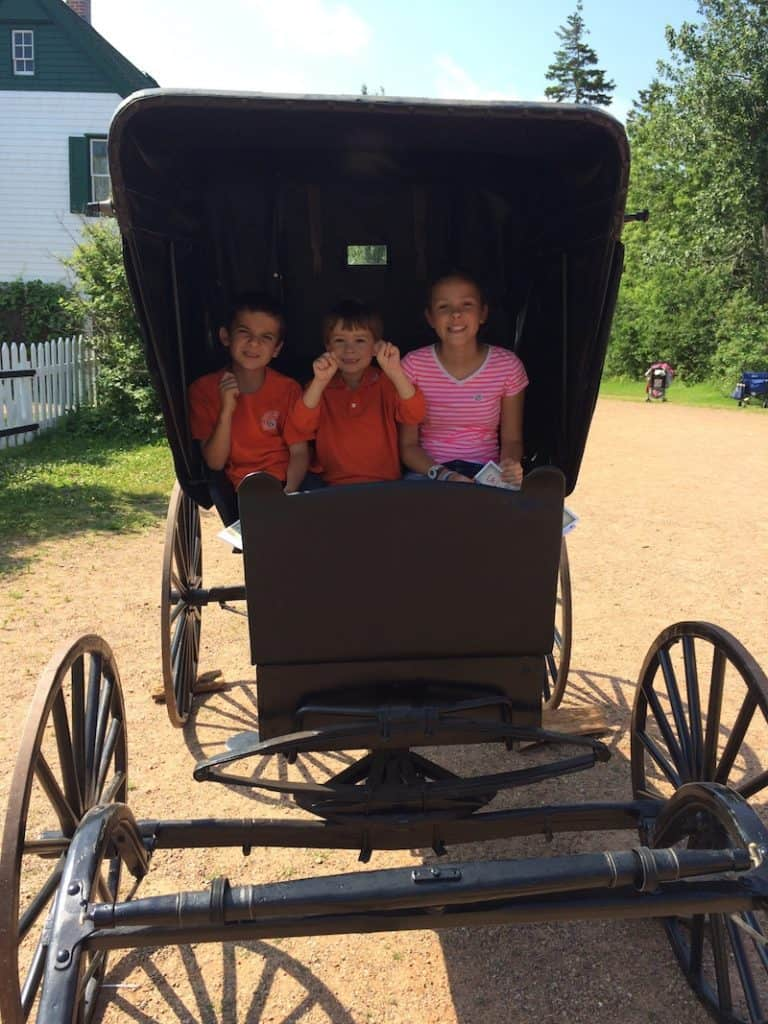 Sit in the carriage. Anne of Green Gables House with kids.