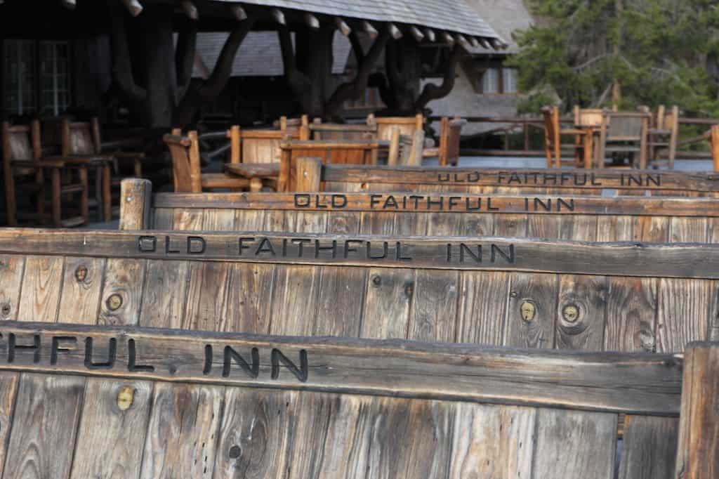 The bench of Old Faithful Inn. Old Faithful Inn with kids.