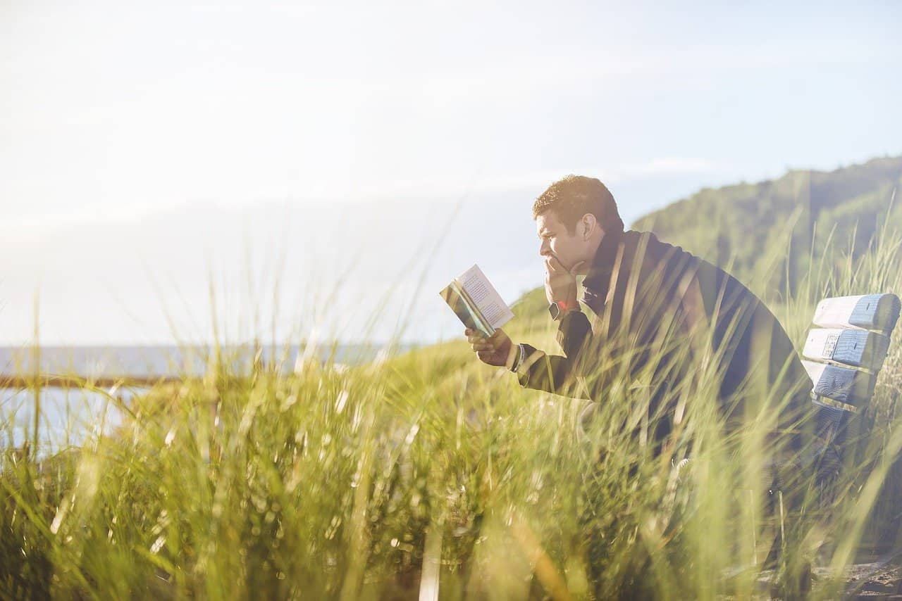 Man reading in nature